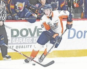 Flint's Connor Roberts looks to get past a Barrie Colts defender. Roberts scored twice in Saturday's loss to Sarnia. Photo courtesy Flint Firebirds
