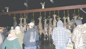 The crowds gather every year to look at the big bucks entered into the annual buck pole contests on Opening Day of the firearms deer hunting season, which falls on Nov. 15 each year. File Photo