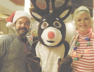 Rudolph made a guest appearance at the 2017 Whatchamacallit, and took a moment to pose for a snapshot with Swartz Creek Chamber Vice President Nathan Shue and ambassador Kali Varner.