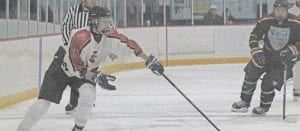 Swartz Creek/Flushing's Colton Giacumbo reaches for the puck during the season-opening loss to Alliance last Wednesday. Photo by Brandon Pope
