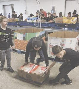 Some helpful kids from Perry Innovation Center in Grand Blanc were on hand for some of the heavy lifting (and dragging).
