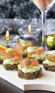 Serving only locally sourced foods at your holiday party is one way to keep the festivities eco-friendly.