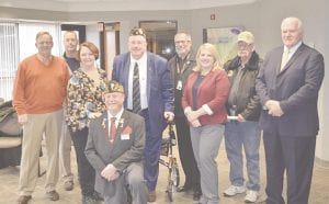 The MTA announced the launch of its Vets to Wellness program at a press conference held last Wednesday at its Flint headquarters. Pictured here are several MTA officials, MTA Board of Directors members and Genesee County veterans. Photo by Ben Gagnon