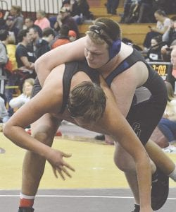 Carman-Ainsworth's Nathan Taylor, shown here at 171lbs. last season, is one of four returning members to the varsity team this year. Photo by Austin VanDaele