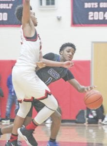 Jayden Nunn, shown here on Dec. 14 against Grand Blanc, scored eight points in Friday's win. Photo by Joe Oster