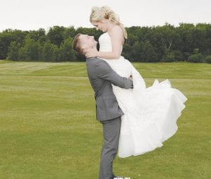 Adam Peterson and Lindsay Shaffer at their June 22 wedding at Captain's Club at Woodfield in Grand Blanc Photo by Centennial Image