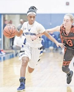 Carman-Ainsworth's Jessiana Aaron battles against Flushing's Keeli Lindstrom at Carman-Ainsworth Friday night. Photo by Todd Boone