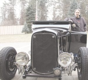 Tom Fahoome of Dryden has been collecting unique and exceptional automobiles for decades, including this 1932 Ford Highboy Roadster, which he will drive to this year's Chrome & Ice indoor car show. The event will be held at the Dort Federal Credit Union Event Center February 8, 9 and 10. Photo by Alex Petrie