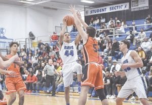 Freshman Mehki Ellison, shown here shooting a floater against Flushing on Jan. 4, dropped seven points in last Friday's victory. Photo by Todd Boone