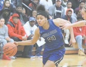 Carman-Ainsworth's Aaliyah McQueen drives hard toward the basket at the Steve Schmidt Roundball Classic inaugural game on Dec. 27. Photo by Kylee Richardson