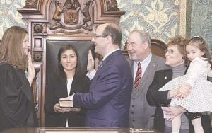 State Rep. John Cherry (D-Flint) takes the oath of office from Michigan Supreme Court Justice Bridget Mary McCormack. Shown here with Rep. Cherry is his wife Teresa Villacorta, his daughter Diana, and his parents former Lt. Gov. John Cherry and former state Rep. Pam Faris. Photo provided