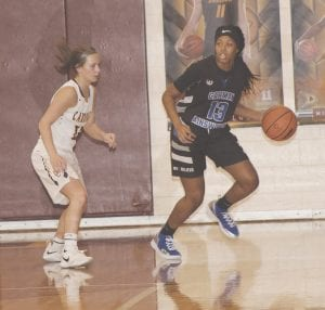 Carman-Ainsworth's Destiny Strother scored 26 points against River Rouge on Saturday. Here, she's shown at Davison back in December. Photo by Lisa Paine