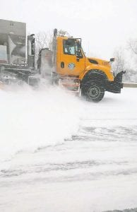 Genesee County Road Commission snow plows took to the roads after Monday's snowfall. Photo by Lania Rocha