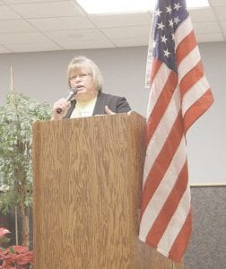 Jean Johnson of the Burton Senior Center addresses the crowd at the opening ceremonies for the Senior Winter Games at the Davison Area Senior Center. Photos by Gary Gould