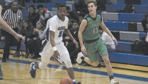 Carman-Ainsworth's Rolaunde McCree leads a fastbreak in last Friday's win over Lapeer. Photo by Brandon Pope