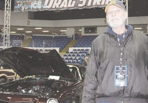Bob Smith, of Flint, poses for a photo with his 1973 Camaro Pro Street in Black Cherry at this year's fourth annual Chrome & Ice indoor car show. The event, held at Dort Federal Credit Union Event Center, was hosted by Back to the Bricks and GM and was the largest on record for the organization. Photos by Alex Petrie