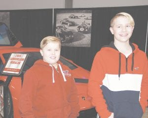 Denver Glasstetter, 11, and his brother, Dakota Glasstetter, 13, both of Grand Blanc, posed for a photo in front of a 2015 Lamborghini Huracan at Saturday's fourth annual Chrome & Ice indoor car show. This year's show had more than 125 classic and vintage automobiles and more than 6,000 guests.