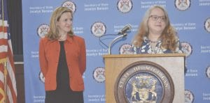 Secretary of State Jocelyn Benson (left) with Flint Township Clerk Kathy Funk (right). Photo by Ben Gagnon