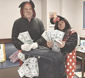 Genesee County Clerk John Gleason (left) dressed as Mickey Mouse, along with a county employee who posed as Minnie Mouse. Photo provided