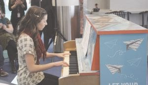 Student Allie Fulton gives a performance on the piano during the press conference held Tuesday. Photos by Gary Gould
