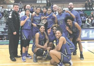 Carman-Ainsworth proudly shows off its Div. 1 district title won at Lapeer last Friday. The Lady Cavaliers lost to defending state champs, Saginaw Heritage, in Monday's regional semifinal at Davison. Photo by Terry Lyons