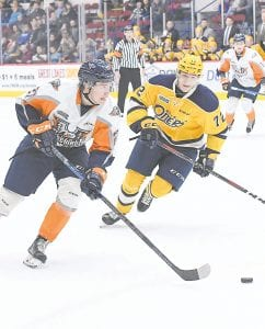 Flint's Riley McCourt skates past a defender during a game against the Erie Otters. Photo by Todd Boone/Flint Firebirds