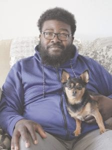 Greg Jones of Grand Blanc, with his dog Queenie. Photo by Gary Gould