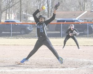 Carman-Ainsworth's Johnson winds up for the pitch at Flushing on Apr. 3. Photo by Todd Boone
