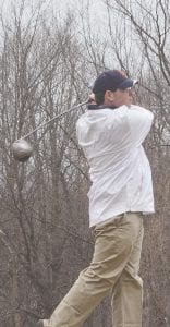 John Karbowski of Carman-Ainsworth watches his tee shot during last season's Tune-Up. Photo by Austin VanDaele