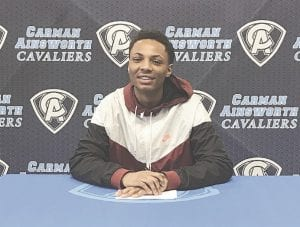 Donnaal Conway poses as he signs his national letter of intent.