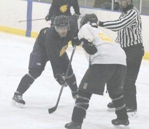 Goodrich and Davison faceoff during last year's Alumni Hockey Tournament. Photo by Brandon Pope
