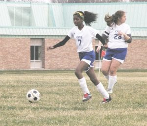 Carman-Ainsworth's Lauren Fisher chases the ball down in a win over Flint on Apr. 17. Photo by Brandon Pope