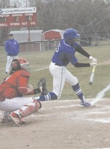 Carman-Ainsworth's Wallace Hill makes a connection during a game against Swartz Creek on April 10. Photo by Brandon Pope
