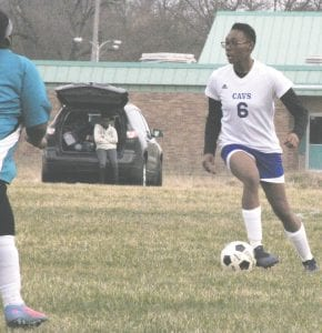 Carman-Ainsworth's Destinee Lester corrals the ball during a game at Flint on Apr. 17. Photo by Brandon Pope