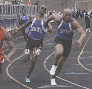 Two Carman-Ainsworth runners make the handoff during Friday's Goodrich Invitational. Photo by Brandon Pope