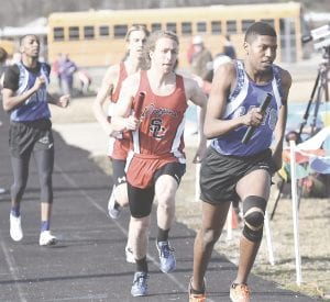 Carman-Ainworth's Joe Chin-Kee-Fatt sprints by a Swartz Creek opponent at the Kearsley Relays on April 5. Photo by Brandon Pope