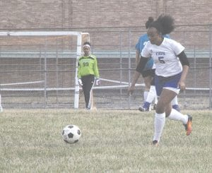 Carman-Ainsworth's Ashley Brown flies into the offensive end at Flint on Apr. 17. Photo by Brandon Pope