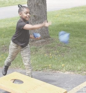 Here, Nadia Rushing tosses a bean bag in a game against her father, Darrell Rushing. Photos by Gary Gould