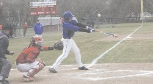Carman-Ainsworth's Ezekiel Ochodnicky makes a connection during a game against Swartz Creek on April 10. Photo by Brandon Pope