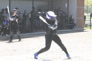 Carman-Ainsworth's Kendall Brown steps into her swing during a battle with Bendle on May 22. Photo by Brandon Pope