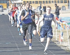 Carman-Ainsworth's Trent Barron, left, tries to take the lead at the Kearsley Relays on April 5. Photo by Brandon Pope