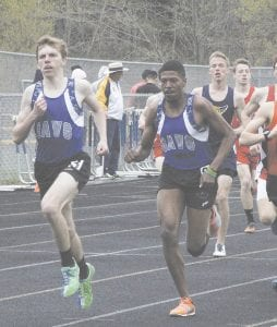 Carman-Ainsworth's Jack Carter, left, and Joe Chin-Kee-Fatt lead the pack at the Goodrich Invitational on May 3. Photo by Brandon Pope