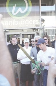 Mark Wahlberg cuts the ribbon officially opening the Wahlburgers at Genesee Valley Center. Photos by Gary Gould