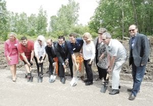 Officials from Mundy Township, Genesee County and the Miracle League of Greater Flint broke ground on a 100-acre recreational facility on Hill Road last week. Photo by Lania Rocha