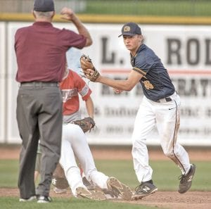 Goodrich's Colby Phipps tags out a North runner as he attempts to steal second. North beat South, 11-7. Photo by Lamont Lenar