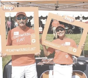 From left, Rory and Linda Cordova from the HAP Flint Pharmacy Department were showing off their team spirit.
