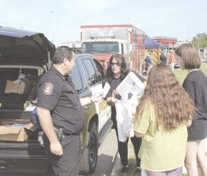 Flint Township Police Community Resource Ofc. John Chisa greeted those attending the event.