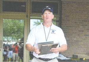 Former Lapeer girls' golf coach, Steve Carlson, addresses the teams at last season's Tune-Up. Photo by Austin VanDaele