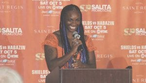 Flint's pro boxer Claressa Shields smiles as she steps to the podium during Wednesday's press conference at the Dort Federal Event Center. Photo by Brandon Pope