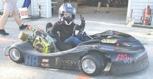Alissa Wilson gets ready to race at Owosso Motorsports Park in her custom-fabricated go-kart. Alissa, who turns 10 on Friday, has been racing all summer. Photos provided by Richard Wilson
